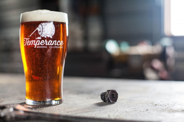 Temperance Brewing company pint of beer on a bar table