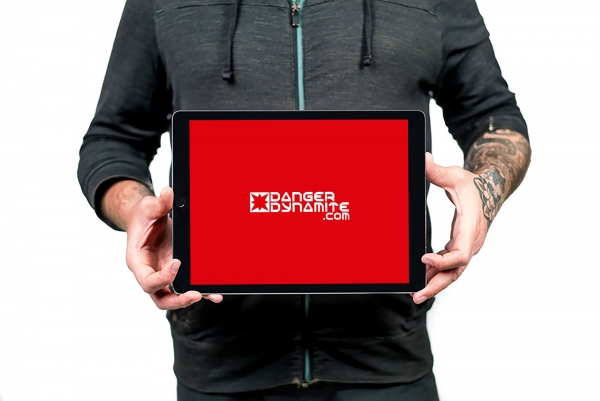 Frank Collins holding a tablet with the dangerdynamite logo front and center
