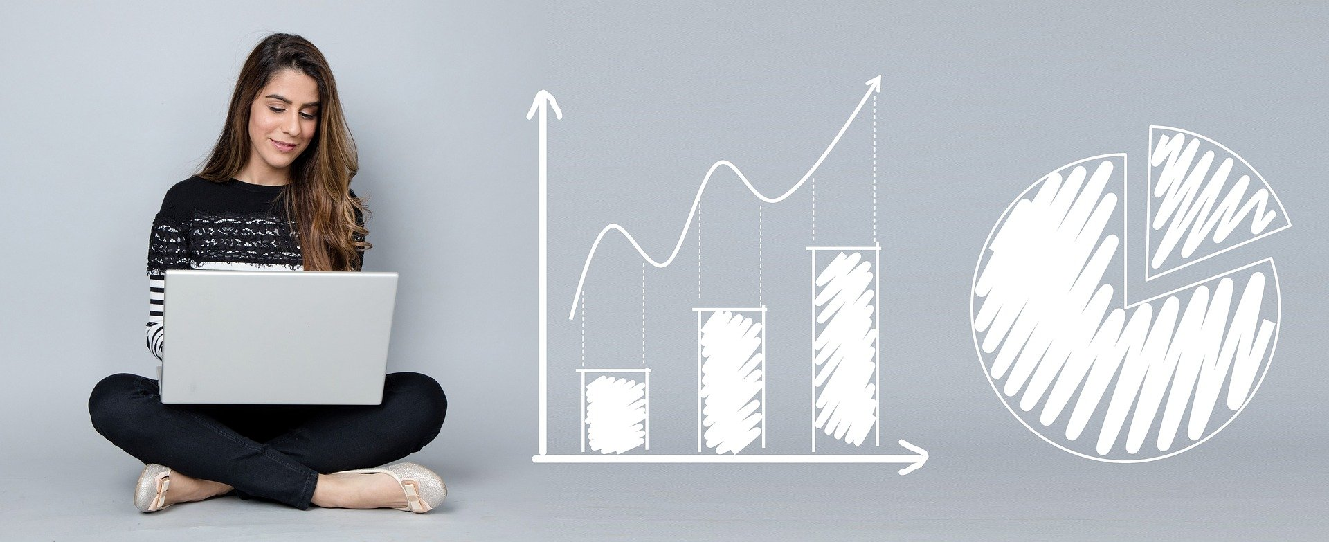 Woman writing custom content with graphs showing an increase in website traffic analytics